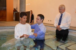 Thomas being baptized two weeks ago.