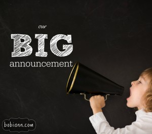 Kid shouting through vintage megaphone against blackboard